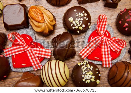 gourmet chocolates for Valentine's Day on wood - stock photo