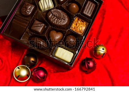 Gourmet chocolates in a square box.