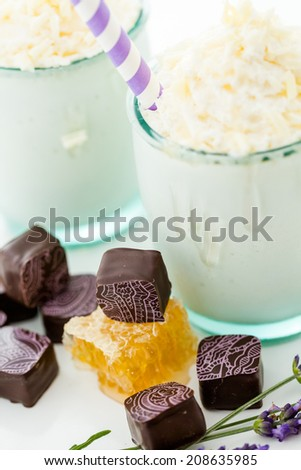 Gourmet cold honey lovender chocolate drink garnished with white chocolate.