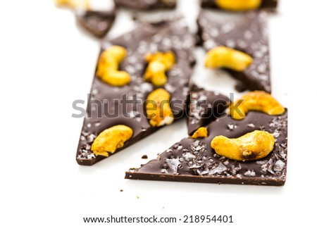 Gourmet Cosmic cashew chocolate bar on a white background. - stock photo