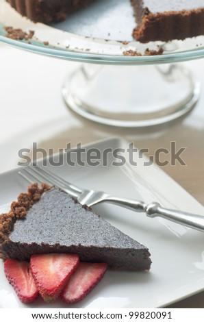 Gourmet dark chocolate rich baked dessert with ginger cookie crust - stock photo