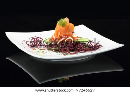 Gourmet dish. Smoked salmon with vegetables - stock photo