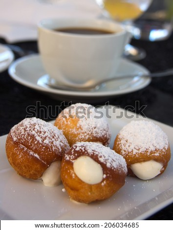 Gourmet donuts and cup of coffee - stock photo
