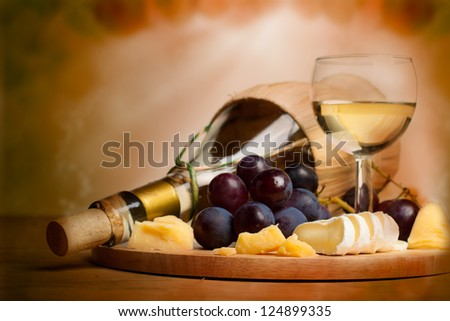 Gourmet food background, border with wine, cheese and grapes - stock photo