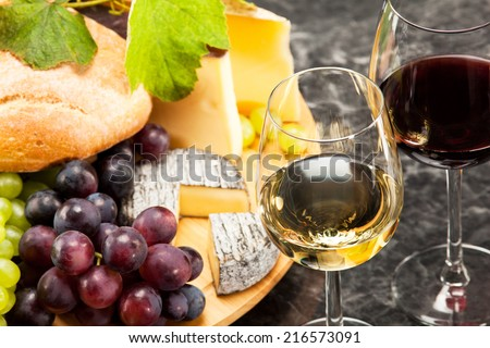 Gourmet food, cheese plate with grapes and bread to wine - stock photo