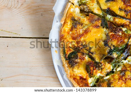 Gourmet food: closeup on delicious homemade broccoli and spinach quiche baked to a perfect golden crust and sliced up, ready to be eaten.