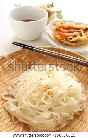 Gourmet food from Japan Aktia Prefecture, Inaniwaudon on bamboo basket with Tempura on background - stock photo