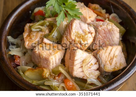 Gourmet fresh salmon pieces cooked with vegetables - stock photo