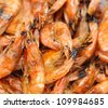 Gourmet Grilled shrimp with original stove between picnic. - stock photo