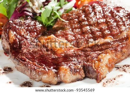 Gourmet grilled steak on a plate - stock photo