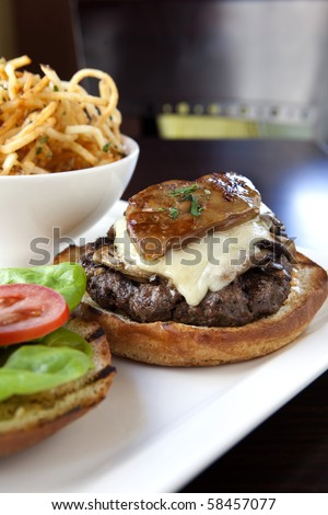 Gourmet Hamburger with duck liver and French Fries - stock photo