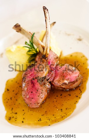 Gourmet Main Entree Course Grilled Lamb steak with spicy Pepper - stock photo