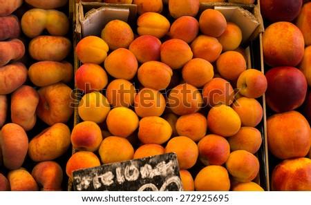 Gourmet Marketplace wit peaches - stock photo