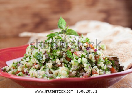 Gourmet Middle Eastern salad Tabbouleh with pita bread - stock photo