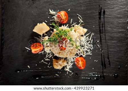 Gourmet Mushroom Risotto with Parmesan and Cherry Tomato - stock photo