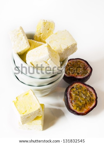 Gourmet passion fruit marshmallows on white background.