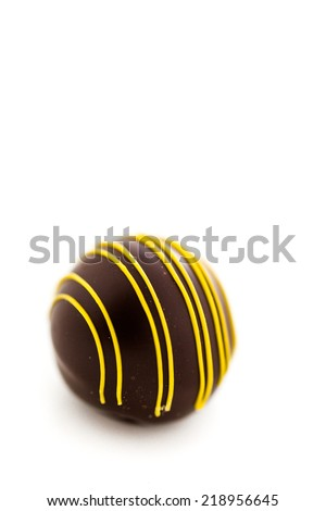 Gourmet passion fruit truffle on a white background.