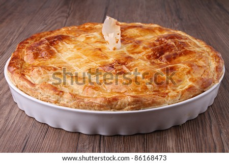 gourmet pie on wooden background - stock photo