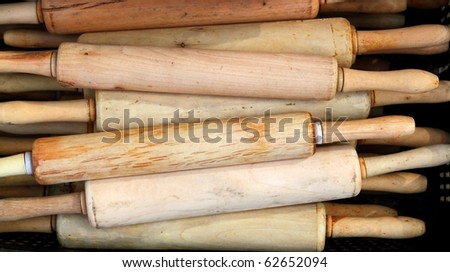 Gourmet Rolling Pin kitchen tool for bakery dough stacked - stock photo