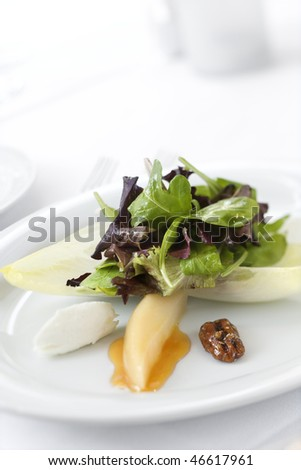 Gourmet salad dish in an upscale restaurant restaurant. Vertical shot. - stock photo
