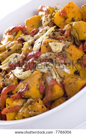 Gourmet salad dish of roasted red peppers, pumpkin, artichokes and eggplant, topped with herbed crumbs
