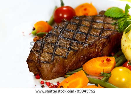 Gourmet Steak with Cherry Tomato,Carrots,Green Beans - stock photo