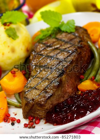 Gourmet Steak with Green Beans,Potato,Cranberry,Carrot - stock photo