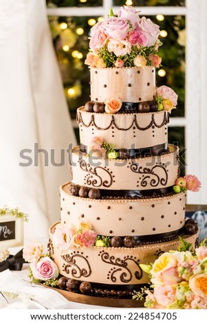 Gourmet tiered wedding cake at wedding reception. - stock photo