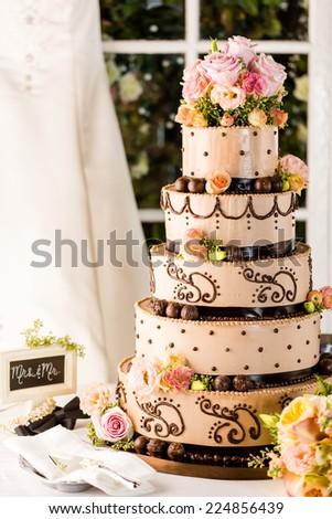 Gourmet tiered wedding cake at wedding reception. - stock photo
