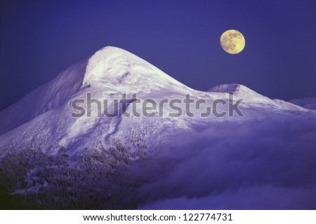 Goverla and Moon The moon rises over the ridge of Montenegro - stock photo