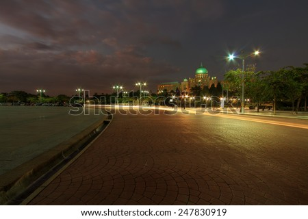 Government architecture lighten up with light trail at night in Putrajaya  - stock photo