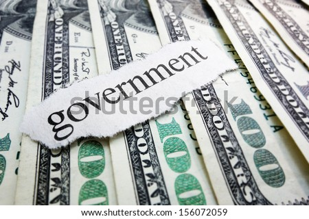 Government newspaper scrap on assorted money                                - stock photo