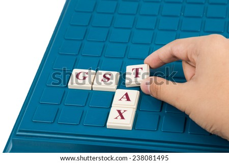 Government Service Tax concept. GST TAX alphabet letters on a board game.