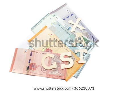 Government Service Tax concept. Money on white background with GST alphabet letters.