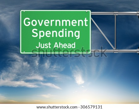 Government spending just ahead . Street exit sign showing the increase of government spending in the future. - stock photo