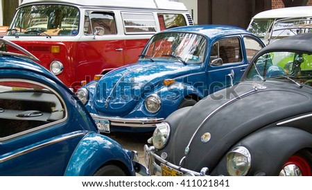 GOVERNORS ISLAND, NEW YORK - CIRCA 2014: Volkswagen Beetle cars and bus parked