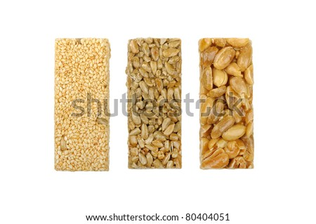 gozinaki of sunflower seeds sesame seeds and peanuts isolated on a white background - stock photo