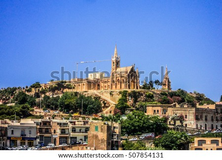 Gozo, Malta, July 20, 2012: Lourdes Church, a neo-gothic monument in village of Mgarr