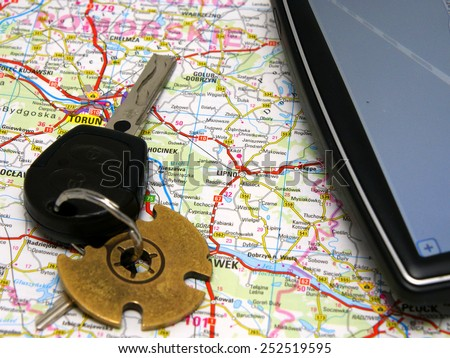 GPS (Global Positioning System) set: GPS device, car keys on the road map background  - stock photo