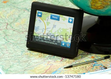 gps navigation on a map and globe - stock photo