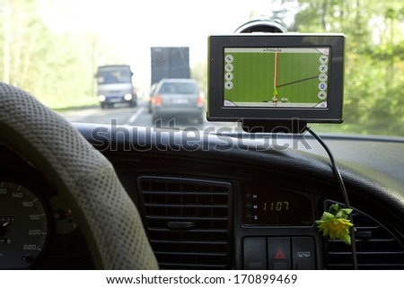 GPS Navigation system in a traveling car.  - stock photo