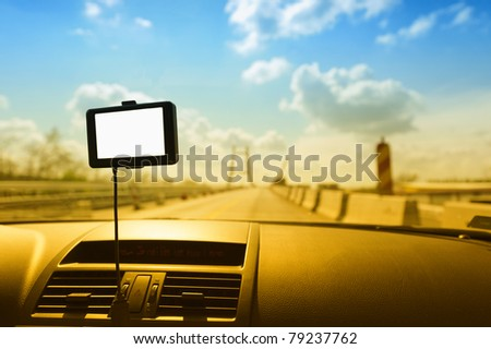 GPS navigation system on a car dashboard. Useful file for your brochure about security, travel and other transportation services. Blank display to fill your data in