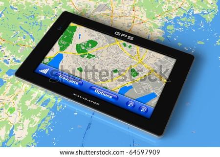 GPS navigator on map - stock photo