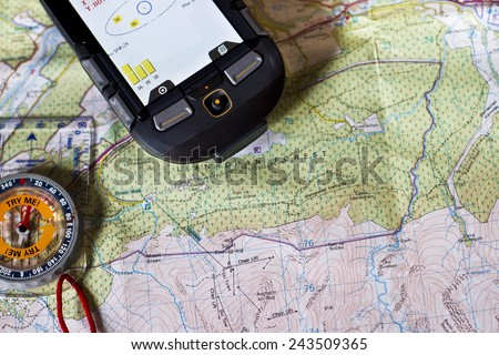 GPS,  Paper Map and a Compass - stock photo