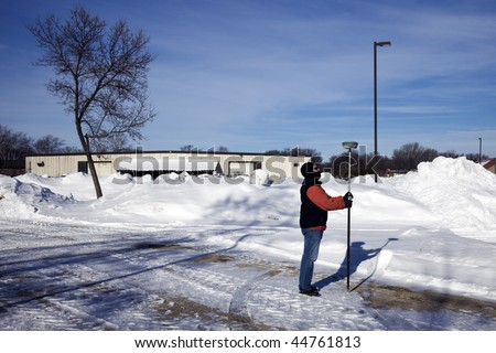 GPS survey of industrial area - winter time. - stock photo