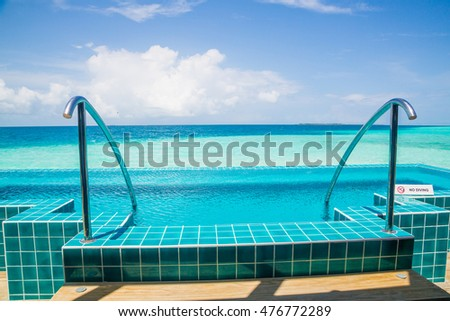Grab bars ladder in the swimming infinity pool on Maldives