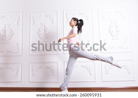 Grace young girl jumping exercises in Studio - stock photo