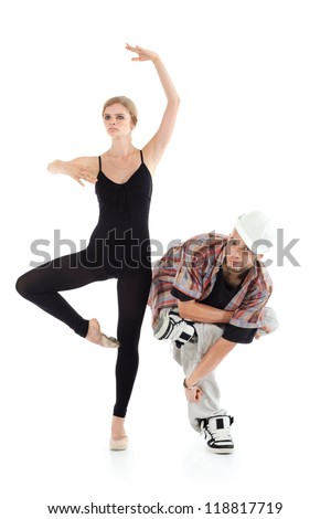 Graceful ballerina and breakdancer in helmet poses isolated on white background. - stock photo