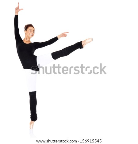 Graceful ballerina training in a black leotard and leggings practising her ballet positions over a white background