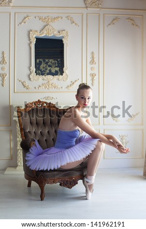 Graceful ballet dancer posing, studio shot - stock photo